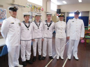 Chief Petty Officer, Shaun Logan with some of the Cadets of the TS Bendigo and Naval Chaplain, Rev Miles Fagan